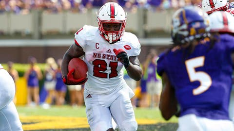Sep 10, 2016; Greenville, NC, USA;  North Carolina State Wolfpack running back Matthew Dayes (21) carries the ball against the East Carolina Pirates during the third quarter at Dowdy-Ficklen Stadium. East Carolina Pirates defeated the North Carolina State Wolfpack 33-30. Mandatory Credit: James Guillory-USA TODAY Sports