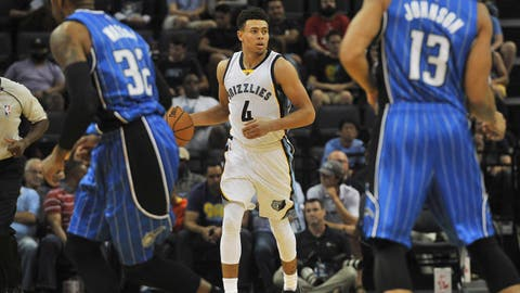 Oct 3, 2016; Memphis, TN, USA; Memphis Grizzlies guard Wade Baldwin IV (4) brings the ball up court against Orlando Magic guard C.J. Watson (32) and guard Nick Johnson (13) during the second half at FedExForum. Memphis beat Orlando 102-97. Mandatory Credit: Justin Ford-USA TODAY Sports