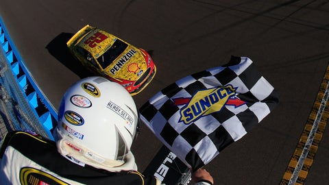 Logano takes the checkers