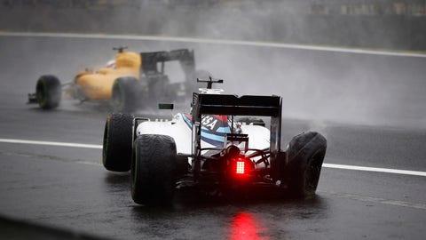 Massa crashes out