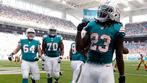 Miami Dolphins at Baltimore Ravens, 1 p.m. CBS (706)