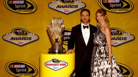Jimmie Johnson and wife Chandra with championship trophy, 2013