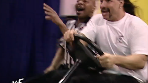 Backstage segment: Al Snow and Teddy Long are out of control on a golf cart