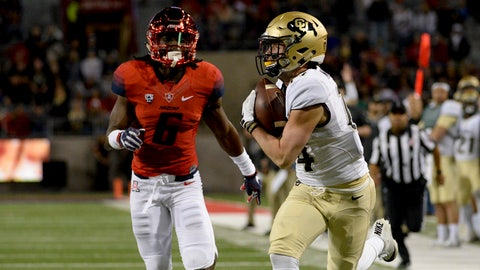 Nov 12, 2016; Tucson, AZ, USA; Colorado Buffaloes wide receiver Jay MacIntyre (14) catches the ball in front of Arizona Wildcats safety Demetrius Flannigan-Fowles (6)during the second quarter at Arizona Stadium. Mandatory Credit: Casey Sapio-USA TODAY Sports