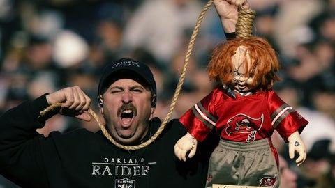 A Raiders fan with Chucky doll representing Jon Gruden