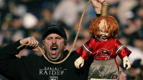 A Raiders fan with Chucky doll representing Jon Gruden