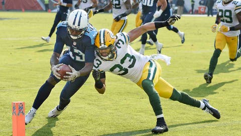 Tennessee Titans wide receiver Kendall Wright beats Green Bay Packers defensive back Micah Hyde to the end zone as Wright scores a touchdown on a 6-yard pass reception in the first half of an NFL game Sunday, Nov. 13, 2016, in Nashville, Tenn.