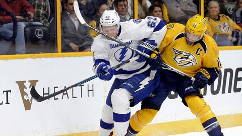 Tampa Bay Lightning defenseman Andrej Sustr (62), of the Czech Republic, and Nashville Predators center Mike Fisher (12) chase after the puck during the second period of an NHL hockey game Monday, Nov. 21, 2016, in Nashville, Tenn. (AP Photo/Mark Humphrey)