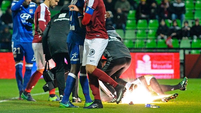 Lyon goalkeeper taken to hospital after fans throw firecrackers at him