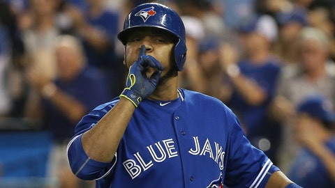 TORONTO, CANADA - SEPTEMBER 19: Edwin Encarnacion #10 of the Toronto Blue Jays celebrates after hitting a two-run home run in the sixth inning during MLB game action against the Boston Red Sox on September 19, 2015 at Rogers Centre in Toronto, Ontario, Canada. (Photo by Tom Szczerbowski/Getty Images)