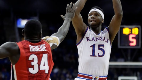 Kansas' Carlton Bragg Jr. (15) shoots over Georgia's Derek Ogbeide (34) during the first half of an NCAA college basketball game Tuesday, Nov. 22, 2016, in Kansas City, Mo. (AP Photo/Charlie Riedel)