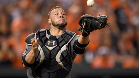 FILE - In this Sept. 23, 2016, file photo, Arizona Diamondbacks catcher Welington Castillo makes a catch on a bunt by a Baltimore Oriole during a baseball game in Baltimore. Castillo was among 35 players who became free agents when their teams declined to offer 2017 contracts on Friday, Dec. 2. (AP Photo/Nick Wass, File)