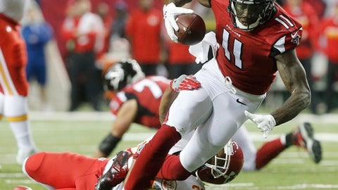 Atlanta Falcons wide receiver Julio Jones (11) heads to the turf after a reception against Kansas City Chiefs cornerback Steven Nelson (20) during the first half of an NFL football game, Sunday, Dec. 4, 2016, in Atlanta. (AP Photo/John Bazemore)