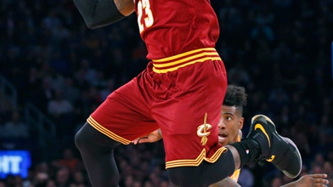 Cleveland Cavaliers forward LeBron James (23) passes to a teammate in the first quarter of an NBA basketball game at Madison Square Garden in New York, Wednesday, Dec. 7, 2016. Cleveland Cavaliers guard Iman Shumpert (4) backs up the play. (AP Photo/Kathy Willens)