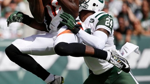 FILE - In this Sept. 11, 2016, file photo, Cincinnati Bengals' A.J. Green (18) catches a pass in front of New York Jets' Darrelle Revis (24) during the first half of an NFL football game, in East Rutherford, N.J. The Bengals play the Cleveland Browns on Sunday, Dec. 11, 2016. (AP Photo/Kathy Willens, File)