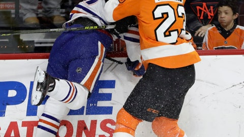 Philadelphia Flyers' Brandon Manning, right, checks Edmonton Oilers' Connor McDavid during the first period of an NHL hockey game, Thursday, Dec. 8, 2016, in Philadelphia. (AP Photo/Matt Slocum)