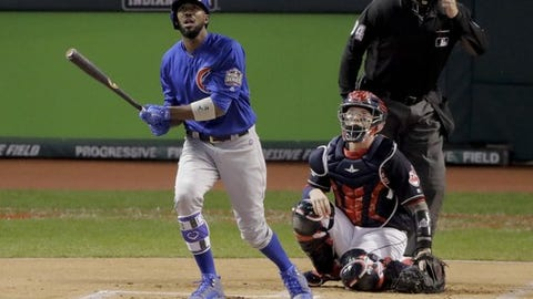 Chicago Cubs' Dexter Fowler watches his home run against the Cleveland Indians during the first inning of Game 7 of the Major League Baseball World Series Wednesday, Nov. 2, 2016, in Cleveland. (AP Photo/Charlie Riedel)