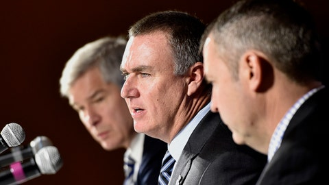 Shawn Elliott, center, speaks at an NCAA college football press conference where he was introduced as the head football coach for Georgia State, Friday, Dec. 9, 2016, in Atlanta. He was joined by Georgia State president, Mark Becker, left, and director of athletics, Charlie Cobb, right. (David Barnes/Atlanta Journal-Constitution via AP)