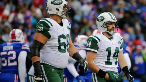 New York Jets quarterback Ryan Fitzpatrick (14) and Breno Giacomini (68) leave the field after Fitzpatrick fumbled the ball during the first half of an NFL football game against the Buffalo Bills Sunday, Jan. 3, 2016, in Orchard Park, N.Y. (AP Photo/Bill Wippert)