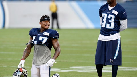 FILE - In this Aug. 8, 2016, file photo, Tennessee Titans' Antwon Blake (47) and Brice McCain (33) talk during a scrimmage at NFL football training camp scrimmage in Nashville, Tenn.  The Titans have had two weeks since releasing veteran Perrish Cox to figure out who will start opposite cornerback Jason McCourty. Veterans Valentino Blake and Brice McCain and rookie LeShaun Sims have been competing for the chance against Denver on Sunday.(AP Photo/Mark Zaleski, File)