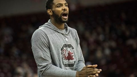 FILE - In this Dec. 4, 2016, file photo, South Carolina guard Sindarius Thornwell cheers on his teammates from the bench during the second half of an NCAA college basketball game against Florida International in Columbia, S.C. South Carolina will be hard pressed to keep up its undefeated start, facing two difficult tasks on the road without suspended leading scorer Sindarius Thornwell. (AP Photo/Sean Rayford, File)