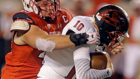 FILE - In this Sept. 1, 2016, file photo, Utah defensive end Hunter Dimick, left, sacks Southern Utah quarterback Tannon Pedersen (10) in the second half during an NCAA college football game in Salt Lake City. Dimick shared defensive player of the year honors with USC cornerback Adoree' Jackson on the Associated Press All-Pac-12 team announced on Friday, Dec. 9, 2016. (AP Photo/Rick Bowmer, File)
