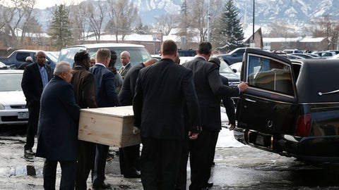Pallbearers carry the casket for  late Heisman Trophy winner and former Colorado running back Rashaan Salaam, following his funeral at the Islamic Center of Boulder, Friday, Dec. 9, 2016, in  Boulder, Colo. Former teammates joined family and friends to say goodbye to Salaam on Friday. About 250 people gathered for a funeral prayer for Salaam at an Islamic house of worship near Folsom Field, where Salaam carved his name into the University of Colorado record book from 1992 to 1994. (AP Photo/Brennan Linsley)