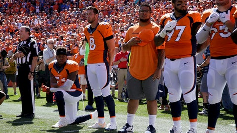 FILE - In this Sept. 18, 2016, file photo, Denver Broncos inside linebacker Brandon Marshall takes a knee during the national anthem before an NFL football game against the Indianapolis Colts in Denver. Marshall posted a racist, threatening letter he received denouncing him for taking a knee during the anthem earlier this season. (AP Photo/Jack Dempsey, File)