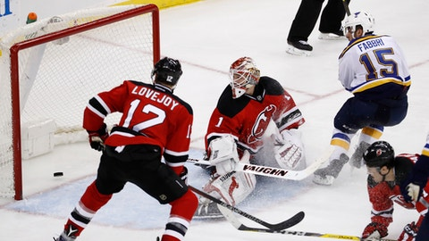 St. Louis Blues center Robby Fabbri (15) watches as his shot enters the net of New Jersey Devils goalie Keith Kinkaid (1) during the third period of an NHL hockey game, Friday, Dec. 9, 2016, in Newark, N.J. Also seen are Devils' Ben Lovejoy (12) and PA Parenteau (11). (AP Photo/Julio Cortez)