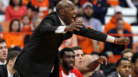 Boston University head coach Joe Jones yells to his players during the first half of an NCAA college basketball game against Syracuse in Syracuse, N.Y., Saturday, Dec. 10, 2016. (AP Photo/Nick Lisi)