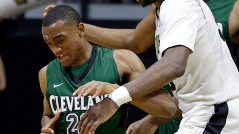 Purdue forward Caleb Swanigan (50) fouls Cleveland State guard Bobby Word (20) in the first half of an NCAA college basketball game in West Lafayette, Ind., Saturday, Dec. 10, 2016. (AP Photo/Michael Conroy)