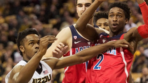 Missouri's K.J. Walton, left, pushes away Arizona's Kobi Simmons, right, as Dusan Ristic, center, looks on during the first half of an NCAA college basketball game Saturday, Dec. 10, 2016, in Columbia, Mo. (AP Photo/L.G. Patterson)