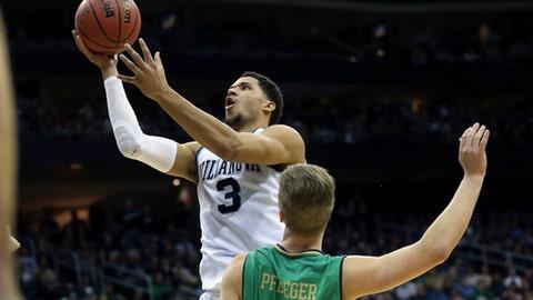 Villanova's Josh Hart (3) goes up for a basket over Notre Dame's Rex Pflueger (0) during the second half of an NCAA college basketball game Saturday, Dec. 10, 2016, in Newark, N.J. Villanova won 74-66. (AP Photo/Mel Evans)