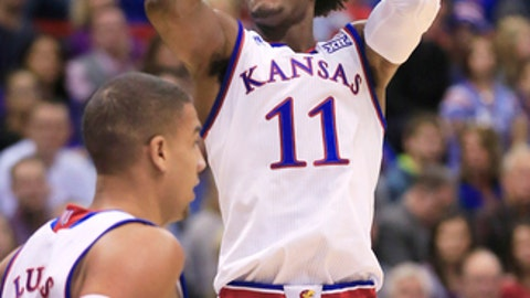 Kansas guard Josh Jackson (11) shoots a basket during the first half of an NCAA college basketball game against Nebraska in Lawrence, Kan., Saturday, Dec. 10, 2016. Jackson scored 17 points in the game. Kansas defeated Nebraska 89-72. (AP Photo/Orlin Wagner)