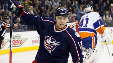 Columbus Blue Jackets' Cam Atkinson, left, celebrates his goal against New York Islanders' Jaroslav Halak, of Slovakia, during the second period of an NHL hockey game, Saturday, Dec. 10, 2016, in Columbus, Ohio. (AP Photo/Jay LaPrete)