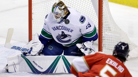 Vancouver Canucks goalie Jacob Markstrom (25) stops a shot by Florida Panthers defenseman Aaron Ekblad (5) in the second period of an NHL hockey game, Saturday, Dec. 10, 2016, in Sunrise, Fla. (AP Photo/Alan Diaz)