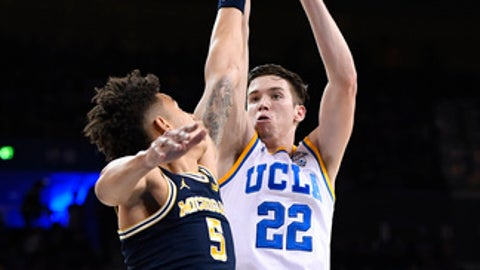 UCLA forward TJ Leaf (22) shoots as Michigan forward D.J. Wilson defends during the first half of an NCAA college basketball game, Saturday, Dec. 10, 2016, in Los Angeles. (AP Photo/Mark J. Terrill)