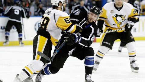 Pittsburgh Penguins defenseman Kris Letang (58) stands up Tampa Bay Lightning right wing Nikita Kucherov (86), of Russia, as he crosses the blue line during the second period of an NHL hockey game Saturday, Dec. 10, 2016, in Tampa, Fla. (AP Photo/Chris O'Meara)