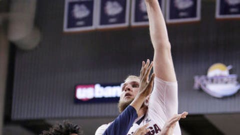 Gonzaga center Przemek Karnowski, center, shoots while defended by Akron center Michael Hughes, left, during the second half of an NCAA college basketball game in Spokane, Wash., Saturday, Dec. 10, 2016. Gonzaga won 61-43. (AP Photo/Young Kwak)