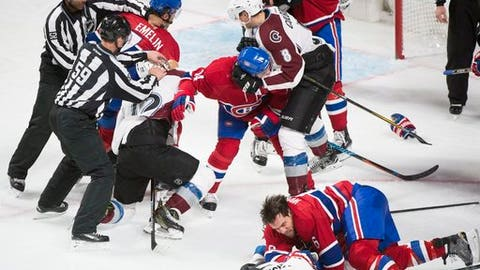 Montreal Canadiens and Colorado Avalanche players brawl during the third period of an NHL hockey game in Montreal, Saturday, Dec. 10, 2016. (Graham Hughes/The Canadian Press via AP)