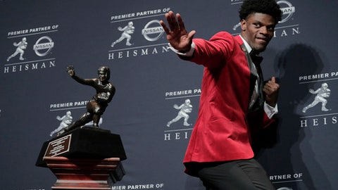 Louisville's Lamar Jackson poses with the Heisman Trophy after winning the award Saturday, Dec. 10, 2016, in New York. (AP Photo/Julie Jacobson)