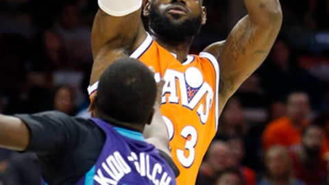 Cleveland Cavaliers' LeBron James (23) shoots over Charlotte Hornets' Michael Kidd-Gilchrist during the first half of an NBA basketball game Saturday, Dec 10, 2016, in Cleveland. (AP Photo/Ron Schwane)
