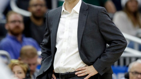 Boston Celtics head coach Brad Stevens calls out to players during the second half of an NBA basketball game against the Orlando Magic, Wednesday, Dec. 7, 2016, in Orlando, Fla. Boston won 117-87. (AP Photo/John Raoux)