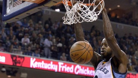 Memphis Grizzlies forward JaMychal Green (0) dunks against Golden State Warriors guard Klay Thompson (11) in the second half of an NBA basketball game Saturday, Dec. 10, 2016, in Memphis, Tenn. (AP Photo/Brandon Dill)