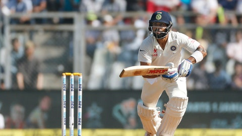 Indian captain Virat Kohli bats on the fourth day of the fourth cricket test match between India and England in Mumbai, India, Sunday, Dec. 11, 2016. (AP Photo/Rafiq Maqbool)
