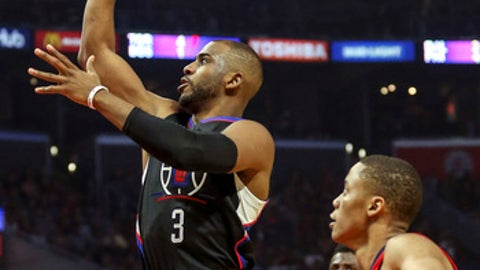Los Angeles Clippers guard Chris Paul goes up for a shot against New Orleans Pelicans during the first half of an NBA basketball game Saturday, Dec. 10, 2016, in Los Angeles. (AP Photo/Ringo H.W. Chiu)
