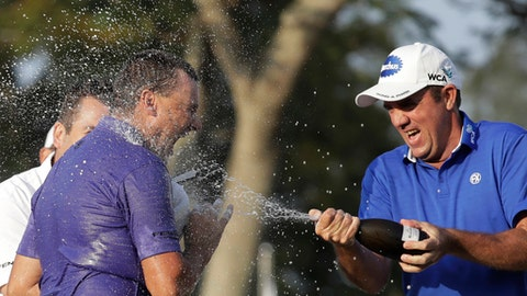 Australia's Sam Brazel, left, celebrates with his supporter after winning the Hong Kong Open golf tournament in Hong Kong, Sunday, Dec. 11, 2016. Brazel birdied the 18th hole to narrowly edge Rafa Cabrera Bello of Spain to capture the Hong Kong Open on Sunday, his first title on the European Tour. (AP Photo/Kin Cheung)