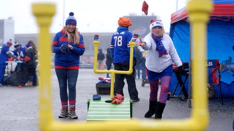 Jill Huffnagle, left, of Lockport, N.Y., and Lisa Lyons, of Amherst, N.Y., play a game while tailgating prior to an NFL football game between the Buffalo Bills and the Pittsburgh Steelers, Sunday, Dec. 11, 2016, in Orchard Park, N.Y. (AP Photo/Adrian Kraus)