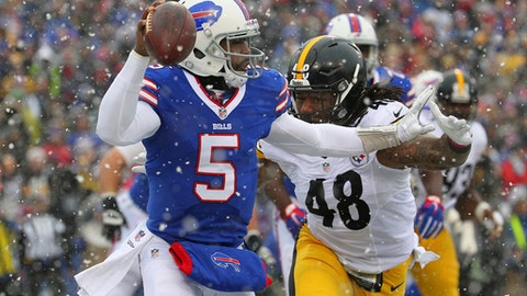 Buffalo Bills quarterback Tyrod Taylor (5) looks to pass as Pittsburgh Steelers outside linebacker Bud Dupree (48) applies pressure on him during the first half of an NFL football game, Sunday, Dec. 11, 2016, in Orchard Park, N.Y. (AP Photo/Bill Wippert)