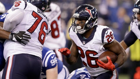Houston Texans running back Lamar Miller runs with the ball during the first half of an NFL football game against the Indianapolis Colts, Sunday, Dec. 11, 2016, in Indianapolis. (AP Photo/Darron Cummings)